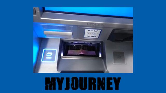 5 Masukkan uang ke dalam mesin ATM BCA